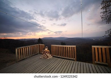 "one young couple, two friends hugging together under a blanket. relaxing in urban area, outdoors in beautiful scenery landscape (national park ""Fruska Gora"", Serbia). Wide angle shot whole environment"