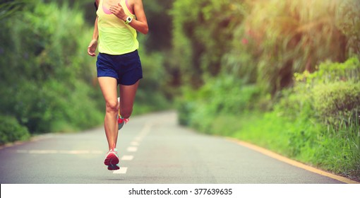 one young fitness woman runner running outdoor
