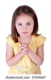 one young girl child begging looking up at viewer and hoping for something