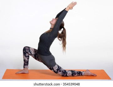 One young healthy sporty caucasian woman exercising yoga on studio background.