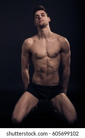 one young man, kneeling sexy handsome abs fit, shirtless body muscular