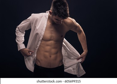 one young man, put on white shirt, abs body