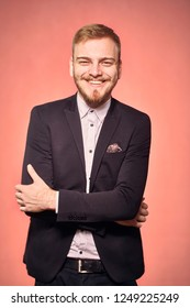 one young man, wearing suit and shirt, 20-29 years old, looking to camera, candid smiling happy, looking friendly. real person, not model. pink background, studio shot, photo shoot.