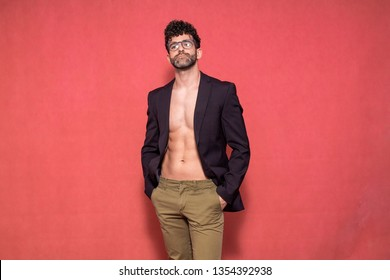 one young sexy handsome man, 30-35 years, posing shirtless, wearing a suit and pants.