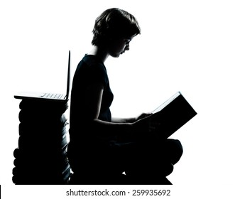 one  young teenager silhouette boy or girl reading full length in studio cut out isolated on white background