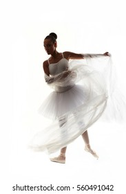 one young woman ballerina ballet dancer dancing with tutu in silhouette studio on white