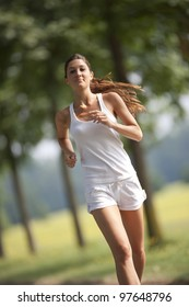 one young woman running outdoors in a sunny day