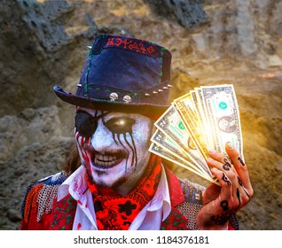 one-eyed pirate robber with eye patch and blood stains holds dollars, burning eye. Halloween. the concept of robbery, dirty dollars, sell your soul for money