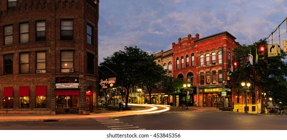 Oneonta, NY, USA - July 14, 2016 downtown, with historic buildings, shops and restaurants in the evening hours. Night scene with car trails, blue hour and lights.