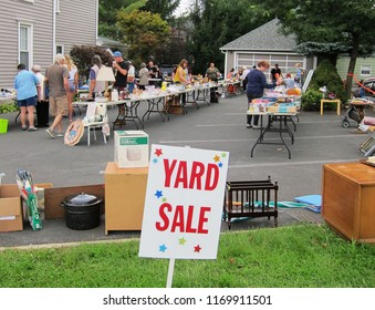 Oneonta, NY / USA - September 1, 2018: A large well attended yard sale or garage sale or tag sale