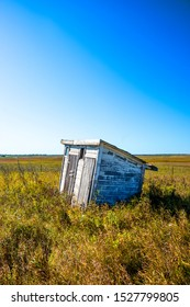 One-room country school outhouse on the North Dakota prairie in late fall.  Two separate sides, one for boys and one for girls