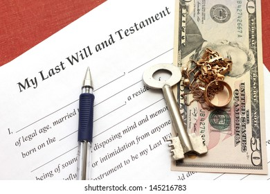 one's last will and testament with gold and money, close-up