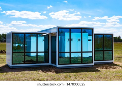One-storey modular houses with large panoramic Windows. House of sandwich panels