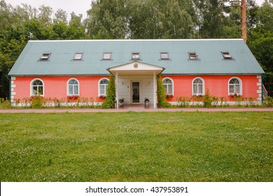 One-storeyed red house with green roof covered by ivy