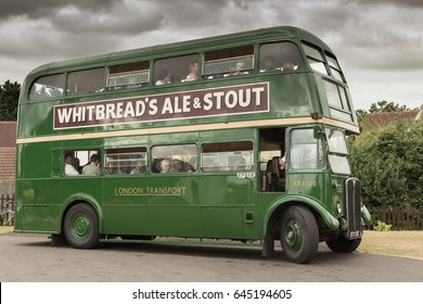 ONGAR, UK - 20, JULY 2013:  Tourists prepare to travel in a vintage Routemaster double decker bus