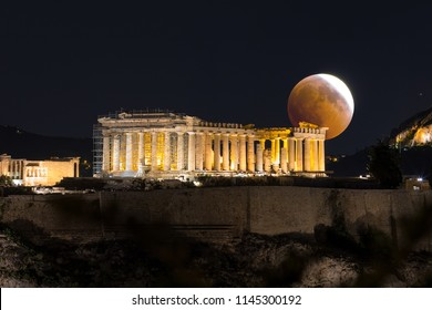 Ongoing full moon eclipse over the Parthenon Temple of the Acropolis of Athens, Greece