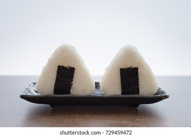 Onigiri, Japanese food, Japanese rice ball, rice triangle with nori seaweed on white background for di cut or text
