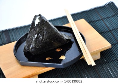Onigiri Japanese rice ball on black plate