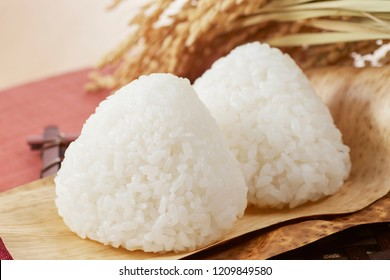 Onigiri, also known as omusubi, nigirimeshi or rice ball, is a Japanese food made from white rice formed into triangular or cylindrical shapes.