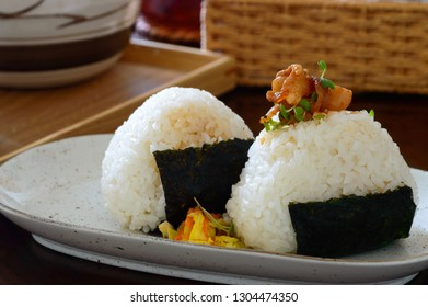 O-nigiri , also known as o-musubi, nigirimeshi , rice ball, is a Japanese food made from white rice formed into triangular or cylindrical shapes and often wrapped with seaweed.