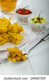 Onion bhajis, czech beer and two sauces - hot and creamy