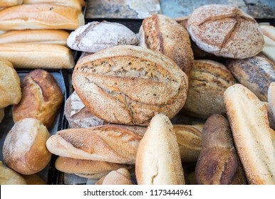 Onion bread and group of baked goods for sale at farmers market
