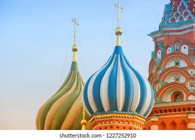 Onion domes with golden crosses of the Saint Basil's Cathedral in Moscow, Russia