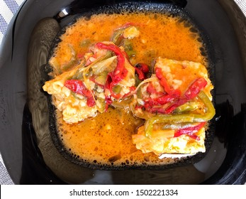 Onion fish cooked in its sauce