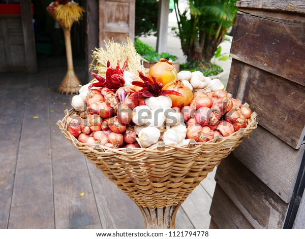 Onion and garlic on the basket design for sell.