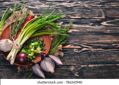 Onion on a wooden background. Top view. Free space for your text.