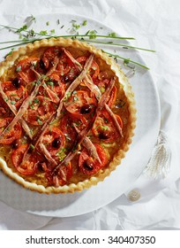 Onion pie with anchovy and tomatoes.