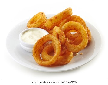 onion rings and dip sauce isolated on white plate
