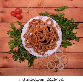 Onion Rings meal on Wood Board background top view flat lay