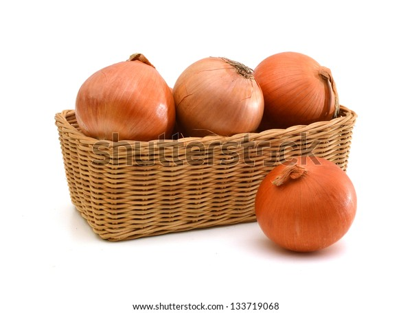onions in the basket isolated on white background