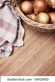 onions in a basket with towel