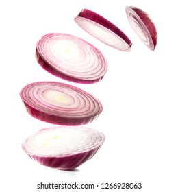 Onions flying above white background