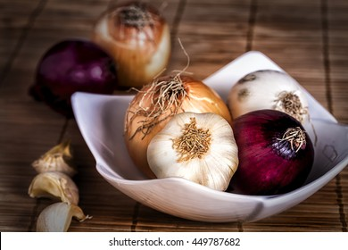 Onions and garlic in bowl. Vegetables food.