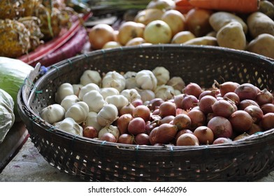Onions and garlic on a market in Hoi Han, Vietnam