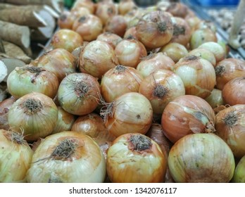 onions for sale in supermarket in the section of hortifruti with background unfocused