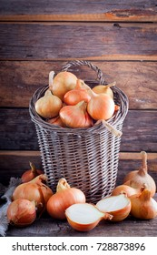 Onions in a wicker basket in a rustic style, selective focus