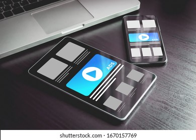 Online advertising on mobile devices. Targeted advertising and marketing industry ads effect concept. Smartphone and tablet pc with programmatic advertising, cross targeting ads on the screen.