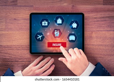 On-line app insurance concept. Businessman (or insurance agent or client) click on button insure and insurance icons: real estate, car, travel, family, financial and health