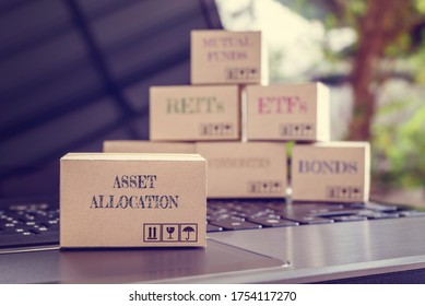 Online asset allocation / portfolio risk diversification for long-term sustainable growth concept : Boxes of asset allocation and financial products e.g bond, commodities, ETFs, REITs on a laptop