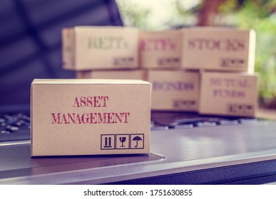Online asset management / portfolio risk diversification for long-term sustainable growth concept : Boxes of financial products e.g bonds, commodities, stocks, mutual funds, ETFs, REITs on a laptop