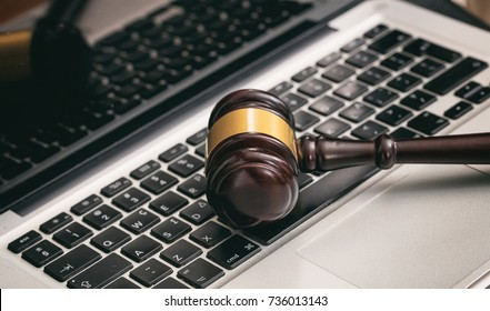 Online auction concept. Auction or judge gavel on a computer keyboard