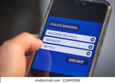 Online banking & internet banking concept. Male hands using smartphone for personal financial transaction on mobile banking app. Front view & close up. All screen graphics are made up with own design