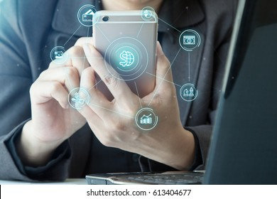 Online banking payment communication network digital technology application development mobile smartphone sync app: Close up hand business woman/ man holding mobile phone with Mobile banking icon flow