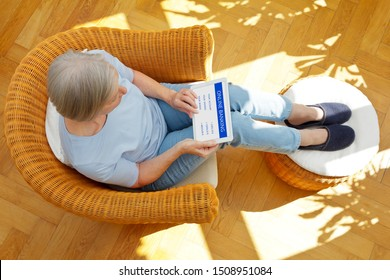 Online banking and senior people concept, elderly woman with tablet pc checking her finances at home
