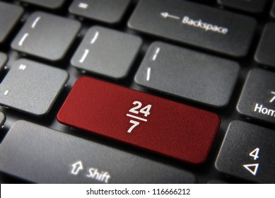Online business always open concept: red key with 24/7 working hours symbol on laptop keyboard. Included clipping path, so you can easily edit it.