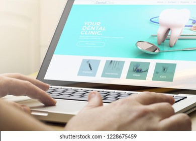 online business concept: man using a laptop with dental concept on the screen. Screen graphics are made up.